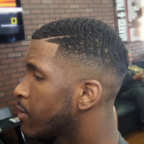 Penteados mohawk para homens negros cabelo curto